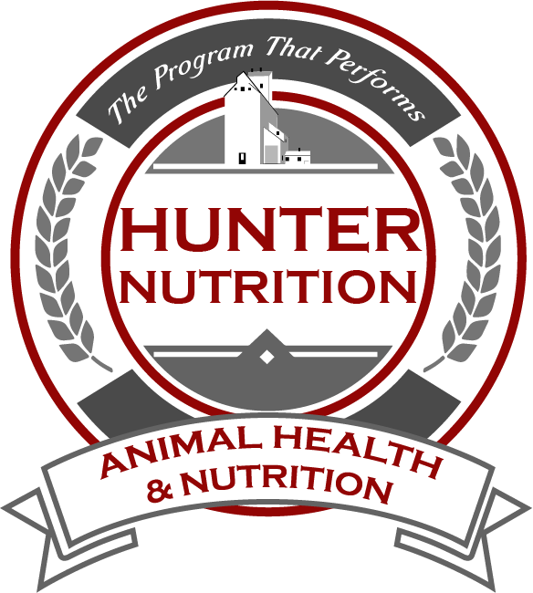 Hunter Nutrition Logo with grain building and laurel leaves that says The Program that Performs!